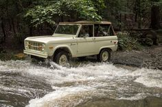 The color on this Early Bronco is superb!  Uncut....cool wheels.....nice top.....sexy driver too.  Perfect for a drive into the river.  Take her up to the headlights man!!!!  The water feels great!