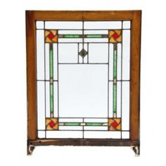 "most unusual early 20th century chicago prairie school interior residential leaded art glass window. the artistic window features strongly pronounced vertical and horizontal lines accentuated with green slag and/or gold leaf sandwich flash glass. unusual and visually striking square floral rosettes are located in each corner. a multitude of smaller pressed ornamental clear glass squares, sharing design characteristics with the ""mackintosh square rose"" of the glasgow (i.e., art nouveau)…"