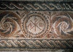 Roman mosaic depicting the Chi-Rho symbol with alpha and omega. Spain. Museum of History. Barcelona. Spain.