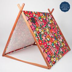 cute floral tent and if you make one with metal tent poles, it'll fold down to backpack size and be the ultimate fort for any sleepover or babysitting job...