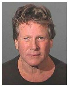 Actor Ryan O'Neal was arrested in February 2007 by the Los Angeles County Sheriff and charged with assault with a deadly weapon and negligent discharge of a firearm after fighting with his son at his Malibu home. Cops allege that O'Neal, 65, got into a fight with his 42-year-old son Griffin and fired a gun during the argument. After posing for the above mug shot the actor was freed on $50,000 bail.