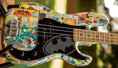 This Bat bass features quite a neatly executed home-made finish, with a decoupage of Batman comic strips on the body itself.  source: http://guitarz.blogspot.com.br/2014/06/batman-ker-pow-knock-off-precision-bass.html