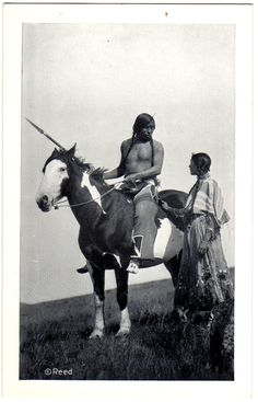 BLACKFEET Chief Medecine Owl and woman, late 1800s or early 1900s. Photo by Roland Reed. Postcard edited c.1915-1930.
