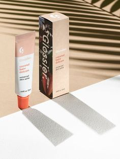 Glossier Coconut Balm Dotcom - A vacation in a luxe little tube, Coconut Balm Dotcom lets you take Tulum with you wherever you go. It's our cult favorite do-anything skin salve with a mood-boosting update—the same super dense formula is made with beeswax and castor seed oil for long-lasting hydration, plant extracts provide antioxidants and skin-enhancing nutrients, and the dreamy coconut scent smells like the best parts of summer.