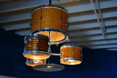 We saw a light fixture like this in a restaurant.  My husband plans to make one from the kids' old drum kit, for over the pool table.  In his spare time.  :-)