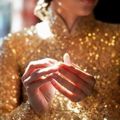 Vietnamese wedding dress. The all glitter ao dai brings a modern yet glamorous touch.
