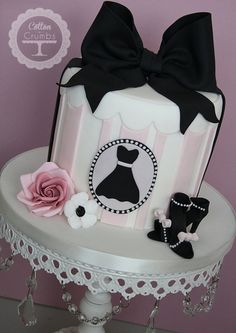 Little #Black #Dress #Cake #Pastel #Pink & #White #Striped with stunning black #Bow and additional #Flower and details! We love and had to share! Great #CakeDecorating!