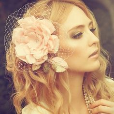 pretty pink flower fascinator ...i like 5he ones with a little bit of netting best