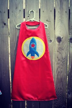 Super Hero Cape With Rocket in Satin fully lined Rocket Ship Party, Outer Space Party, Superhero Capes, Sewing For Kids, Athletic Tank Tops, Sewing Projects, Satin, Children, Soccer