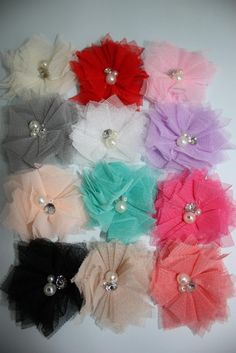 Pearly mesh flowers set on any colour grosgrain ribbon you choose; perfect hair accessory for little girls! Find Us: www.facebook.com/BoudaisyHairAccessories