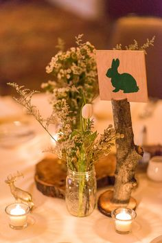 SO CUTE. This #rustic #woodland themed wedding used different symbols for their table markers {Aliza Rae Photography}