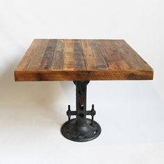 "36"" Solid reclaimed wood top square dining table with original cast iron crank base. Height adjustable from 30"