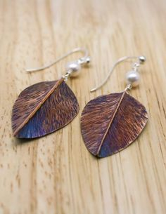 ddb29e519 Hand made copper leaf earrings with freshwater pearls. The leaves have been  hammered and hand