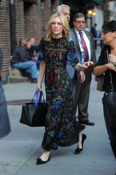 Cate Blanchett wears a floral lace maxi dress with flats and a tote bag