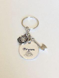 Custom Personalized Firefighter Gift Keychain Choice of 2 Firefighter Charms. Fire Chief Lieutenant Firefighter Wife Firefighter Girlfriend by UniqueAnomaly on Etsy https://www.etsy.com/listing/219066249/custom-personalized-firefighter-gift