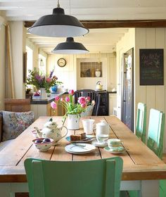 A beautiful mellow kitchen using #vintage finds #recycled #paintedfurniture #kitchen #lights