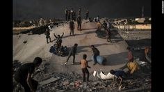 Children play in debris created by an airstrike in Qayyara on Sunday, November 6.