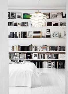 bookshelves not in the bed room prob in the family room or something make one whole wall just shelves