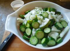 Chopped cucumbers, onions and garlic ready for brining