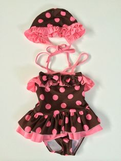 This Girls Cocoa Pink Polkadot 2PCE Bathing Suit & Hat is the cutest swimming costume for the Beach or Pool and sunsmart because of the tie up matching hat. Not many styles like this around. Straps cross at the back. Great beach photo prop outfit for the family album.  www.marigoldkids.com.au