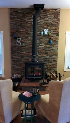 Wood Stove - stacked ledge stone wall with slate shelves, Bennington Hearthstone wood burning stove, concrete raised platform base.cozy!!!