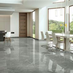 granite flooring Subtle light veining on a polished grey background create a very minimal appearance in both contemporary and traditional applications.Available in a range of sizes Displays of this tile can be seen in our showrooms Marble Porcelain Tile, Polished Porcelain Tiles, Porcelain Floor, Ceramic Floor Tiles, Deco Design, Tile Design, Flur Design, Marble Floor, Grey Floor Tiles