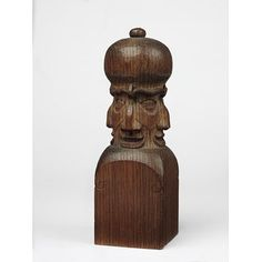 Newel post finial This object links Voysey's furniture and woodwork designs with his practice as an architect, as well as encapsulating his sense of humour. Voysey occasionally designed carvings such as this to cap newel posts in the staircases of his buildings. Voysey was clearly fond of this carving – according to its later owner, the scholar-architect John Brandon-Jones, he used it as a hat stand. The carving is almost identical to six finials which remain on the secondary staircase