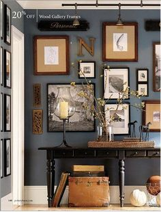 I dont like the color scheme but i love the idea of different sized picture frames and letters.  On TV wall but on a diagonal...