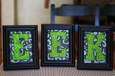 wood letters from hobby lobby  foam brush  patterned paper  5x7 black frames from wal mart  glitter  acrylic paint  glue (we used elmer's)