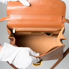 Delvaux Cognac Brillant MM Bag. Buy authentic designer vintage Delvaux bags. LabelLOV webshop safe and secure online shopping