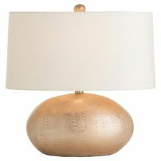 "Cast a warm glow in your home office or entryway with this eye-catching porcelain table lamp, showcasing an oval-shaped base and rose gold-hued finish.  Product: Table lampConstruction Material: Porcelain and microfiberColor: Rose gold and ivoryFeatures:  Python-inspired designUL and cUL approved8' Cord length 3-Way rotary switchAccommodates: (1) 150 Watt bulb - not includedDimensions: 18.5"" H x 18"" W x 11"" D"