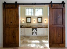 A grand way to separate the master bedroom and bathroom: gorgeous restored sliding barn doors!