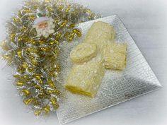 Tronco navideño de ganache blanco con muselina de pistachos. ¡Irresistible!