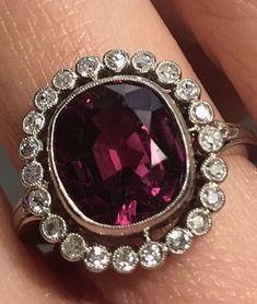 Tourmaline and diamond halo ring