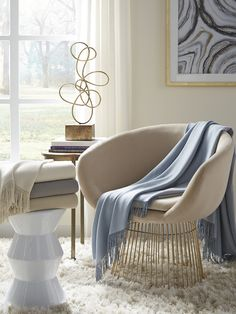Pima cotton and alpaca fibers are blended to create a lightweight throw with cozy warmth. Woven in a flat basket weave pattern and finished with hand-knotted fringe, Bristol offers an elegant, clean look.