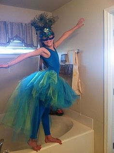 What a pretty little pecoc costume for any girl.