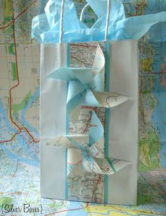 Using old maps to wrap mens gifts.  @Pamela Petkova Boxes #mensgifts #oldmaps