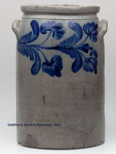 """STAMPED """"W. H. LEHEW & CO / STRASBURG VA."""" VIRGINIA DECORATED STONEWARE JAR, salt glazed, """"3"""" gallon capacity stamp, cylindrical form with squared rim and applied arched handles. Brushed bright cobalt horizontal multi-bloom floral decoration on both sides. Second maker's stamp with reversed Ss. Circa 1860-1875"""