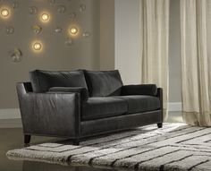The Davlin sofa in charcoal #grey and #mohair has a retro vibe from #bradington_young