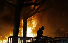FILE - In this Feb. 1, 2017 file photo, a fire set by demonstrators protesting a scheduled speaking appearance by Breitbart News editor Milo Yiannopoulos burns on Sproul Plaza on the University of California, Berkeley campus. UC Berkeley police took a hands-off approach to protesters on the campus last week when violent rioters overtook a largely peaceful protest against a controversial speaker. But that response is being questioned as demonstrators become increasingly hostile and politics…
