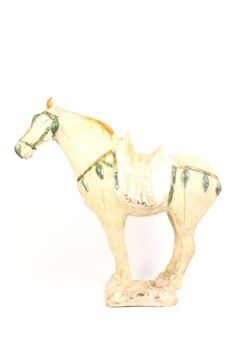 Chinese Tang Dynasty (618–907 AD) style large Sancai glazed pottery sculpture depicting a caparisoned horse standing foursquare with glazed trappings in green and gold throughout. Saddle draped with a thickly textured blanket with remnants of pinkish orange.
