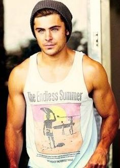 "I have this same tank top Zac is wearing.  ""Endless Summer,"" a film about surfing c1966.  Perfect top to wear with vintage corduroy shorts and espadrilles, giving it a retro vibe."