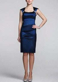 Modern and structured, this sleek, formal dress has just the right amount of vintage appeal!  Sleeveless bodice and dazzling brooches provide an alluring frame for your neckline.  All-over ruching of this taffeta sensation creates a flattering silhouette. Available in Sapphire Fully-lined. Imported polyester. Back zip. Dry clean only.