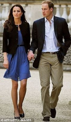 Duke and Duchess of Cambridge, newly married, walk to the waiting helicopter which took them to a secret place where they will have much needed alone time after a huge royal wedding, theirs, the day before.