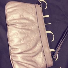 100% Authentic Gucci light Pink Leather Wristlet For for sale is a Light pink leather Gucci Wristlet. Top zip closure with coordinating leather pull. It holds up to 6 card credits. Very spacious to put your cellphone or car keys. Good for travel or a night out. Original $470 no dust bag Gucci Bags Clutches & Wristlets