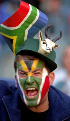 South African Rugby fan, with little springbok on the hat. The South African national rugby team is called: 'The Springboks'
