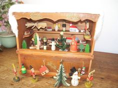 German Christmas market stall filled with wooden holiday decorations and toys. Ca. 1920.  Size:   Width 27 cm, depth 17 cm, height approx 25.5 cm.