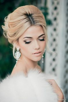 Glamorous winter bride wearing updo and chandelier earrings http://www.planningwedding.net/