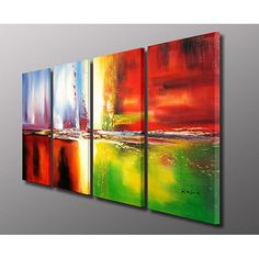 abstract art canvases hang on pale grey wall
