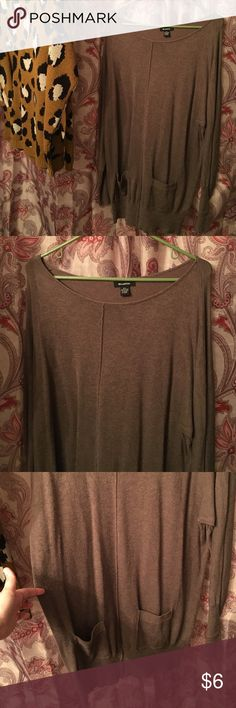 Graffiti tunic sweater with pockets. Size L. Graffiti tunic sweater with pockets. Size L. In good condition. Light weight sweater. 80% viscose 20% nylon. Graffiti Sweaters